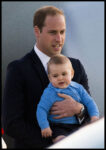 Prince William Suit Holds Prince George Blue Sweater