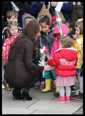Little Girl Red Coat Gives Flowers Kate