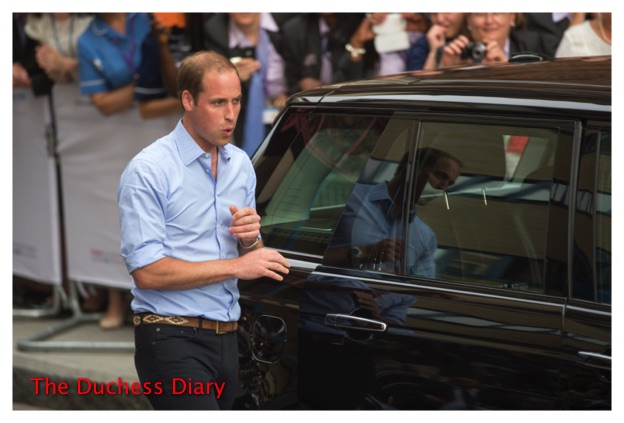Prince William secures Prince George's Car Seat