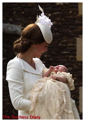 Kate MIddleton Smiles Holds Princess Charlotte