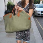 kate middleton smiling carrying green bag