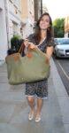 kate middleton smiling carrying green bag