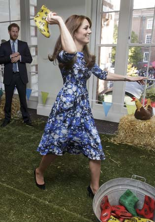 kate middleton throws wellie prince harry watches bafta