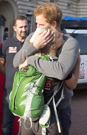 prince harry hugs wounded vet kirstie ennis buckingham palace