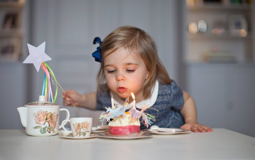 princess leonore third birthday photo blows out candle cupcake