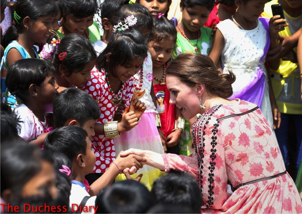 kate middleton shakes hands Pan Bari village children