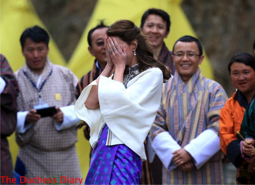kate middleton reacts covers face throws darts bhutan