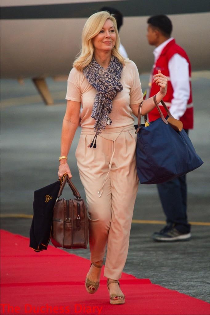 amanda cook tucker arrives bags plane assam