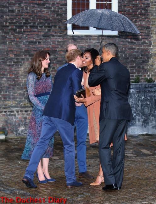 prince harry kises michelle obama kensington palace