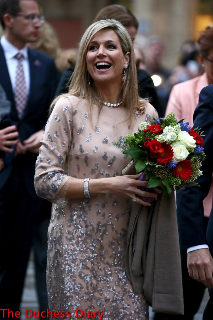queen maxima sparkly dress receives flowers munich