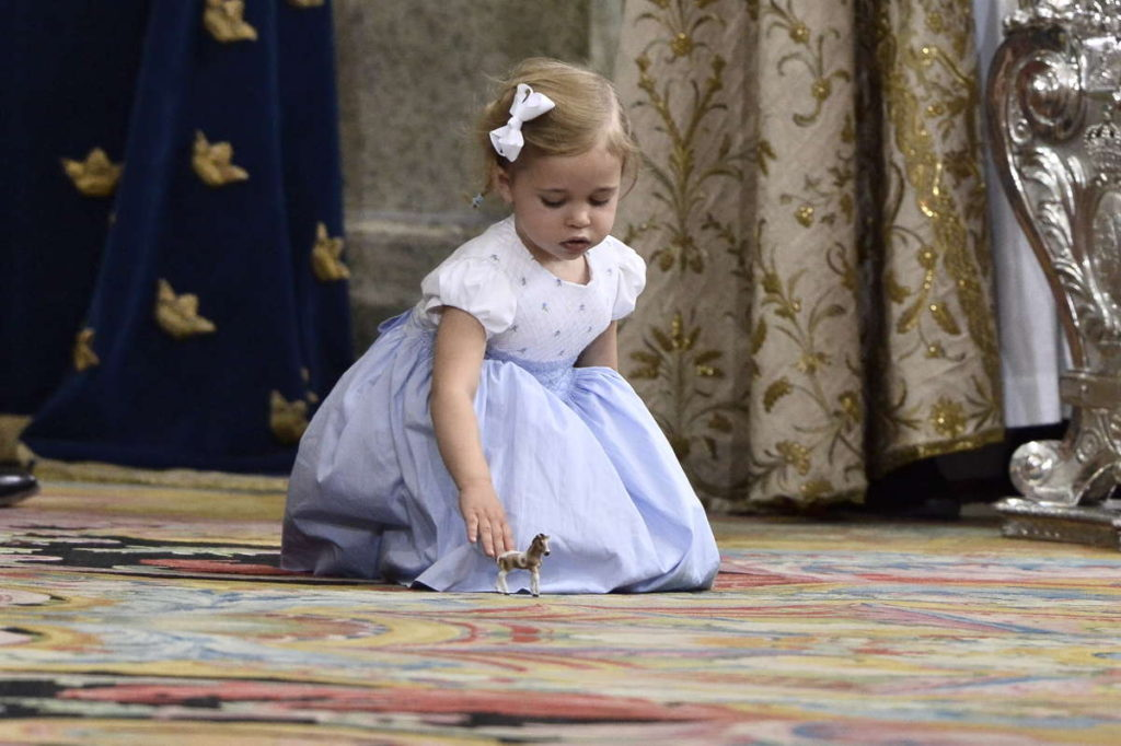 princess leonore sweden blue white dress plays toy horse christening prince oscar
