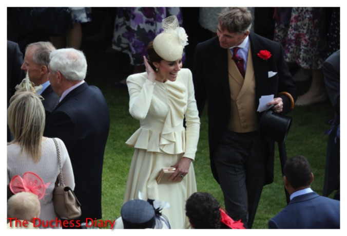 kate middleton fixes hair greets people buckingham palace garden party