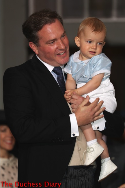 Christopher O'Neill holds Prince Nicolas drottningholm palace prince oscar christening