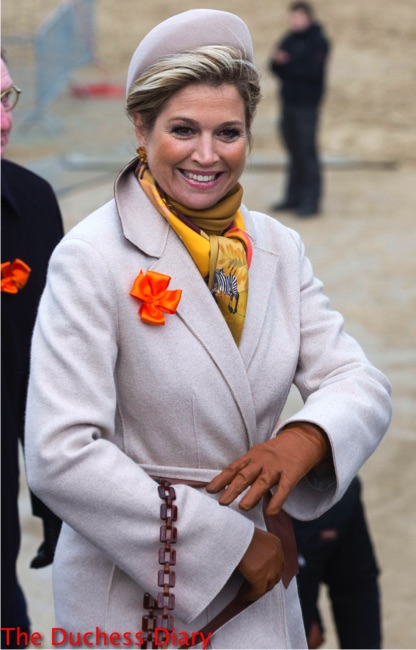 queen maxima grey coat orange flower lapel grey hat