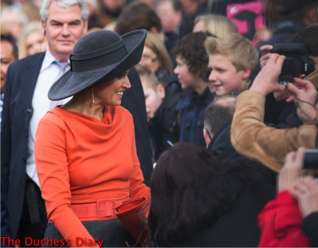 queen maxima orange shirt wide brim black hat visits stenden college