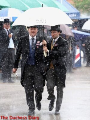 male racegoers keep dry under umbrella rain royal ascot day 1