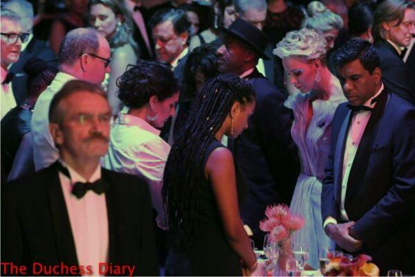 prince albert princess charlene heads bowed moment silence red cross gala 2016