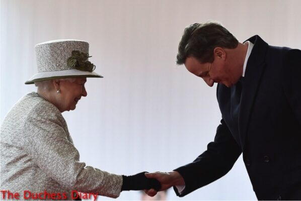 queen greets david cameron bows head