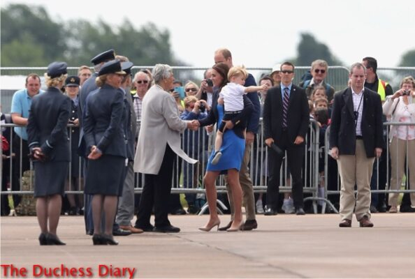 prince george points something held by duchess cambridge