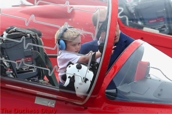 prince george points to something cockpit red arrow