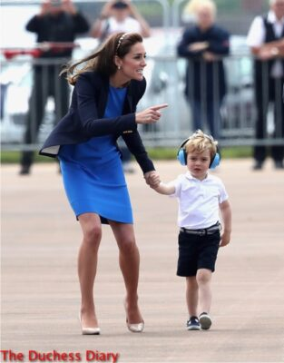 duchess cambridge points prince george hold hands raf fairford