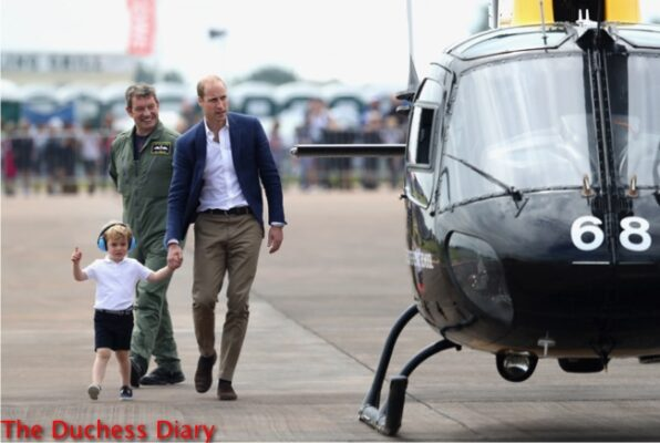 prince william holds prince george hands approach helicopter RAF Fairfrord
