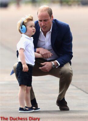 prince william kneels down speaks to prince george raf fairford