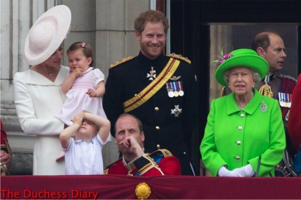 prince george blocks eyes prince william Queen elizabeth prince harry duchess cambridge princess charlotte balcony buckingham paalce