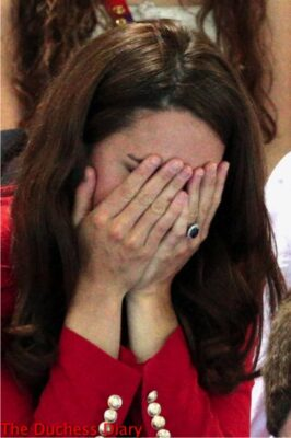 kate middleton covers face red blazer 2012 summer olympics
