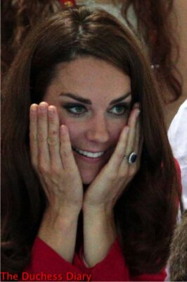 kate middleton hands on face red blazer 2012 summer olympics swimming finals