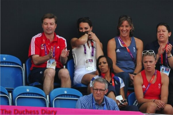 kate middleton white outfit nervously plays with hair women's hockey match 2012 summer olympics