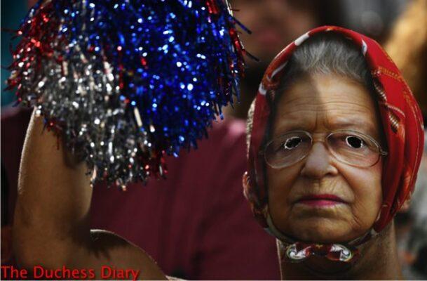 olympic fan wears queen elizabeth mask women's beach volleyball