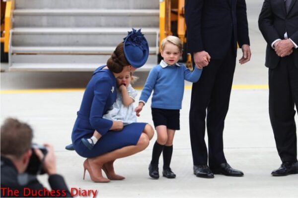 duchess cambridge holds princess charlotte talks to prince george victoria airport