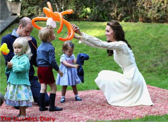 duchess cambridge laughs plays balloons prince george princess charlotte figures out cardigan