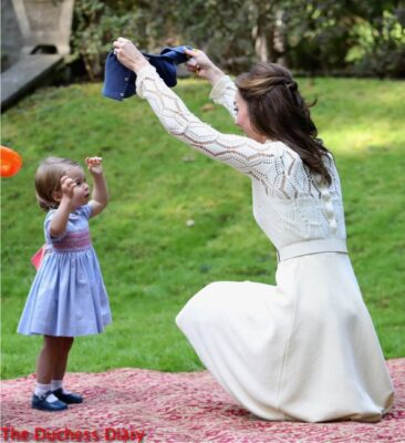 duchess cambridge holds up cardigan princess charlotte children's party caanda