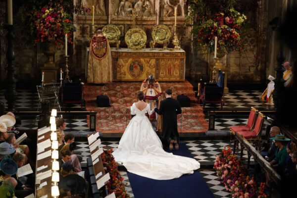 Princess Eugenie Of York and Jack Brooksbank Kneel Receive a Blessing During Their Wedding Ceremony at St. George's Chapel October 2018